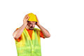 Manuel worker protecting himself from noisy environment isolated on white background Stock Images