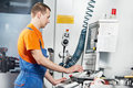 Manufacture technician worker near cnc milling machine center at tool workshop Royalty Free Stock Photos