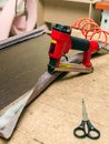 Manufacture of upholstered furniture, furniture upholstery with a pneumatic stapler Royalty Free Stock Photo