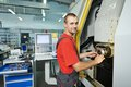 Manufacture worker at tool workshop operating metal machining center factory shop Stock Photography