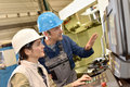Manufacture workers setting up machinery Royalty Free Stock Photo