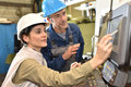Manufacture workers setting up machinery working on electronic machine Royalty Free Stock Photo
