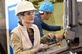 Manufacture workers setting up machines working on electronic machine Stock Photography