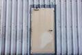 Manufacturing iron door on corrugated metal sheet Royalty Free Stock Photo