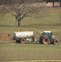 Manuring tractor the fields with liquid manure Stock Image