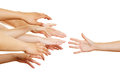 Many arms reaching for helping hand desperate a Royalty Free Stock Photos