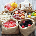 Many assorted sweet sugar candies vintage wooden background Royalty Free Stock Photo