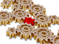 Many big golden gears with one red Stock Photography