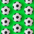 stock image of  Many black and white soccer balls background. Football balls in a water