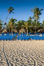 Many blue lounges on white sand beach Royalty Free Stock Photos