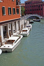 Many boats on venice channel Royalty Free Stock Image