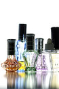 Many bottle with perfume different color isolated on white background Stock Photo