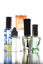 Many bottle with perfume different color isolated on white background Royalty Free Stock Photos