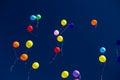 Many bright baloons in the blue sky Royalty Free Stock Photo