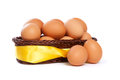 Many brown eggs in basket with yellow ribbon Royalty Free Stock Photography