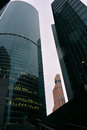 Many buildings of the Moscow business center, from the bottom to the top, diced green stand under a white sky Royalty Free Stock Photo