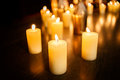 Many burning candles on a mirrored background Royalty Free Stock Photo