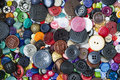 Many buttons of various shapes and colors bright background for needlework Royalty Free Stock Photography