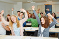 Many cheering students hands raised university class Royalty Free Stock Image