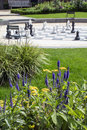 Many chessmen on the street chessboard with plants green and flowers Royalty Free Stock Image