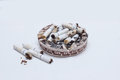 Many cigarette cigarettes in an ashtray Royalty Free Stock Photo