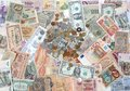 Many coins banknotes of different countries and times money background with Royalty Free Stock Photos