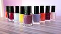 Many colored bottles of nail polish