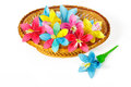 Many colored paper flowers in the basket Stock Image