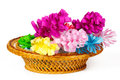 Many colored paper flowers in a basket the Royalty Free Stock Photography