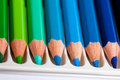 Many colored pencils in a row Stock Photos
