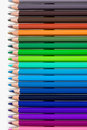 Many colored pencils in row over white background Royalty Free Stock Images