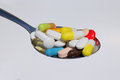 Many colored pills capsules medicine tablets close up Stock Photography