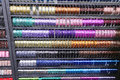Many colored ribbons and decorative rolls for sale per meter in Royalty Free Stock Photo