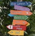 Many colored signs indicating different and directions Royalty Free Stock Photo