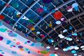 Many colorful abstract decorations hang under a huge glass ceiling in the mall Royalty Free Stock Photo