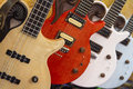 Many colorful electric guitars aligned in a store showroom Royalty Free Stock Photo