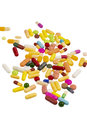 Many colorful pills on a white background symbolic photo for medicine and drugs Stock Photography