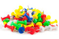 Many colorful push pins on white background Royalty Free Stock Images