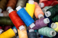 Many colorful reels of threads for embroidery. Royalty Free Stock Photo