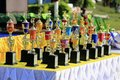 Many colorful sports trophies, football, Petanque, volleyball, rattan ball