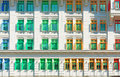 Many-coloured  windows in old vintage classical building Royalty Free Stock Photo