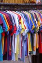 Many colourful cotton t shirts hanging rail Stock Images