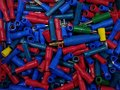 Many colourful plastic tubes in box Royalty Free Stock Photo
