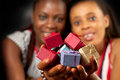 Many colourful presents for you african american female friends holding varicolored varicoloured gifts Stock Photo