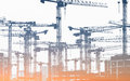 Many construction cranes  - construction site Royalty Free Stock Photo