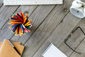Many different colored pencils on wooden desktop Royalty Free Stock Photo