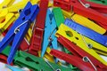 Many different colored plastic clothes pegs close up Royalty Free Stock Photo