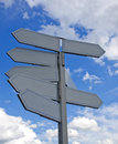 Many directional signs gray painted post with blank Stock Photos