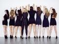 Many diverse women in line, wearing fancy little black dresses, party makeup, vice squad concept