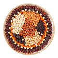 Many dried fruits on a round plate with nuts Stock Image
